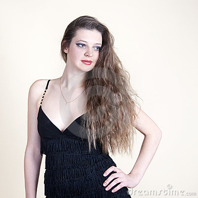Portrait of young beautiful girl in a black dress