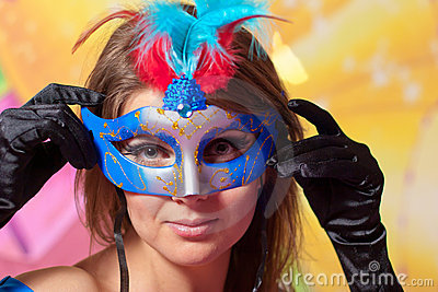 Portrait of young beautiful girl in carnival mask
