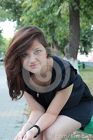 Portrait of a young beautiful girl in a park