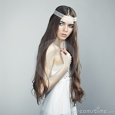 Portrait of a young beautiful girl with wavy hair