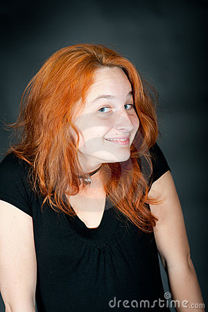 Portrait of a young beautiful redhead woman