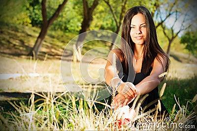 Portrait of young beautiful smiling woman outdoors, enjoying
