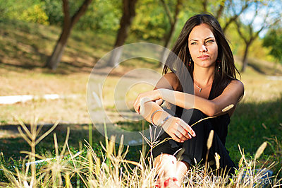 Portrait of a young beautiful thinking woman outdoors