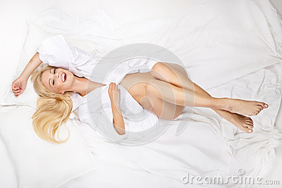 Portrait of young beautiful woman on bed
