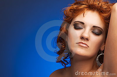 Portrait of young beautiful woman on blue