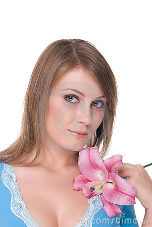 Portrait of young beautiful woman with flower