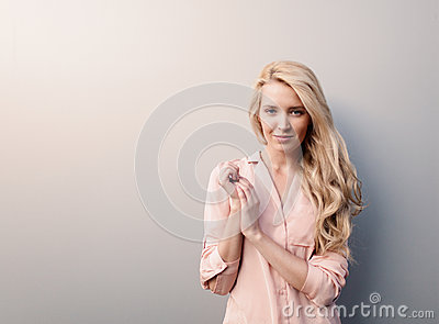 Portrait of young beautiful woman with long hair have fun and good mood looking in camera and smiling