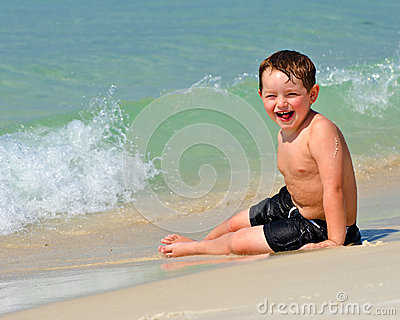 Portrait of young boy playing in surf at beach
