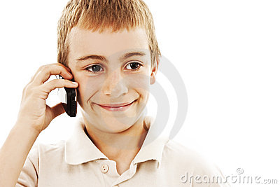 Portrait of a young boy speaking on cellphone
