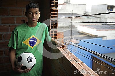 Portrait of Young Brazilian Soccer Player Standing with Football