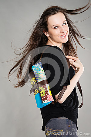 Attractive brunette with a bag