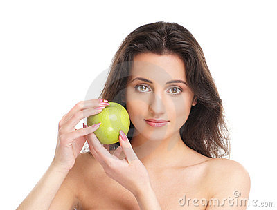 Portrait of a young brunette holdig an apple