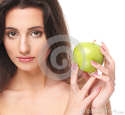 Portrait of a young brunette holding an apple