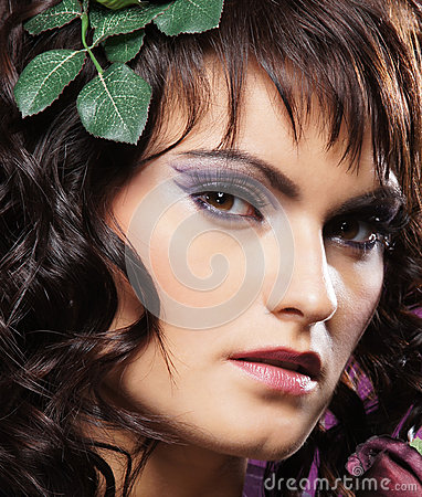 Portrait of a young brunette woman in a makeup