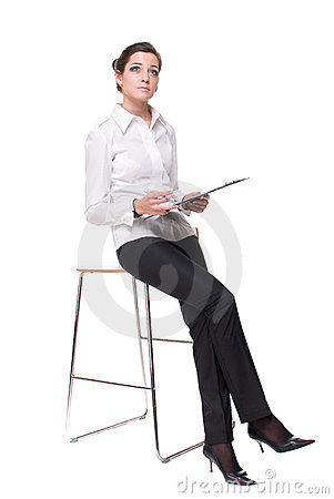Portrait of young business woman on chair