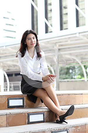 Portrait young business woman with her mobile smartphone