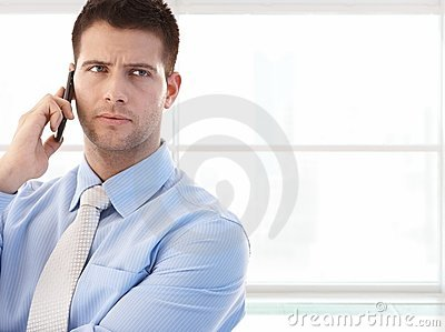 Portrait of young businessman on the call
