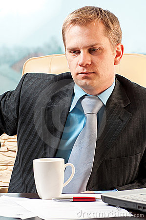 Portrait of a young businessman in doubt about som