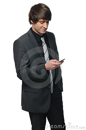 Portrait of a young businessman reading a message