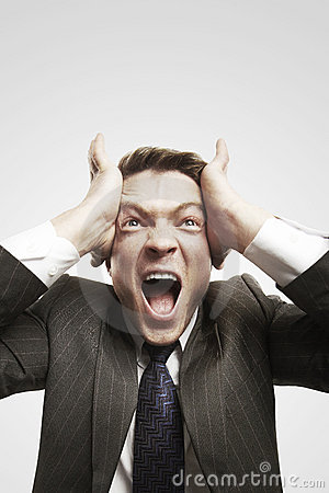 Portrait of young businessman shouting against