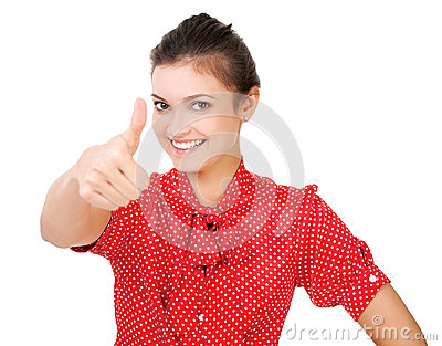 Portrait of a young businesswoman gesturing a thumb up sign