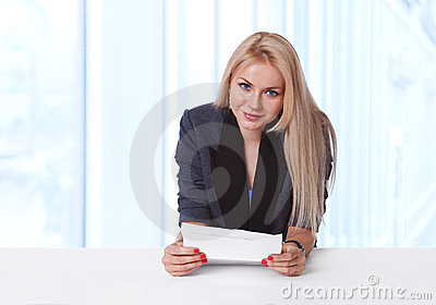 Portrait of young businesswoman holding a contract