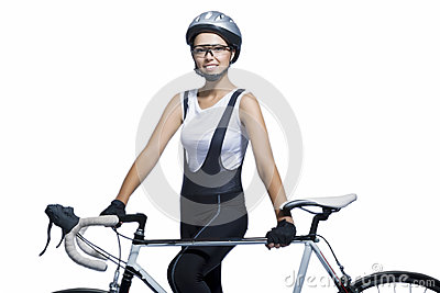 Portrait of young caucasian sportswoman p standing with bicycle
