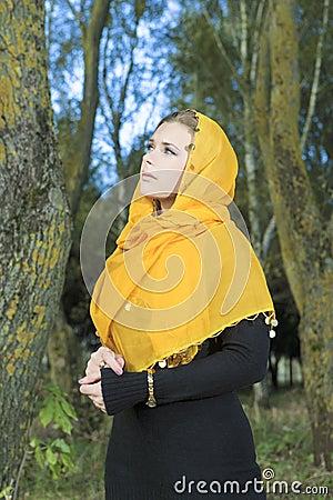Portrait of Young Caucasian Woman in Kerchief