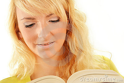 Portrait of young caucasian woman reading a book