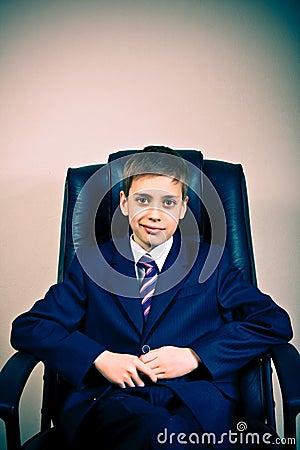 Portrait of young confident business boy