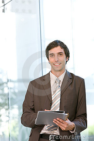 Portrait of young confident business man in focus