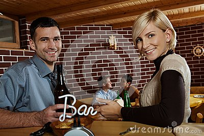 Portrait of young couple in bar