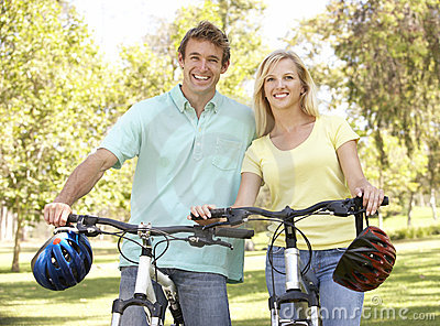 Portrait Of Young Couple On Bike Ride