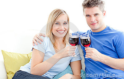 Portrait of a young couple clinking glasses