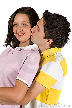 Portrait of young couple kissing