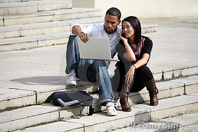 Portrait of a young couple with laptop