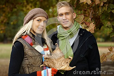 Portrait of young couple outdoors at autumn