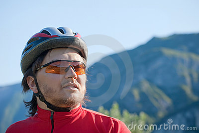 Portrait of a young cyclist in helmet