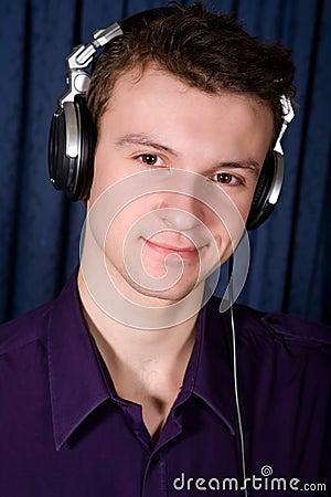Portrait of young DJ indoors