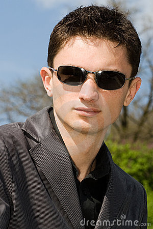 Portrait of young European man in sunglasses