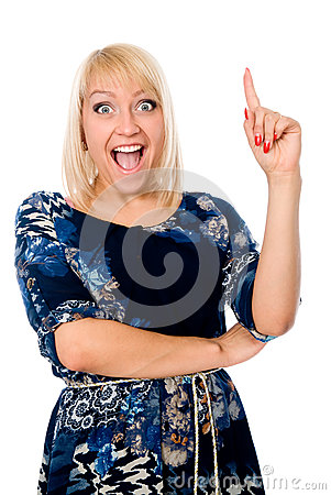 Portrait of young excited woman pointing up and smiling.
