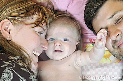 Portrait of young family with  cute little babby