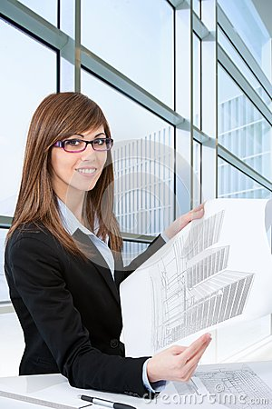 Portrait of young female architect with plans.