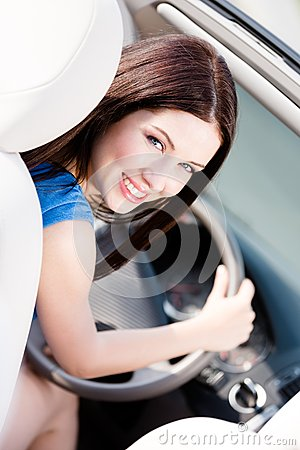 Portrait of young female driver