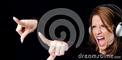 Portrait of young female enjoying music