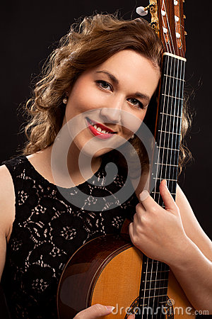 Portrait of young female guitar player