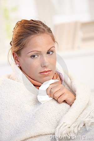 Portrait of young female having flu feeling bad