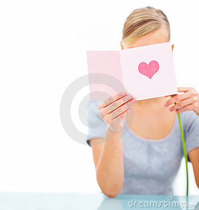 Portrait of young female reading valentine card