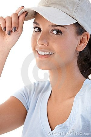 Portrait of young girl in baseball cap smiling