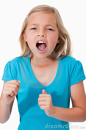Portrait of a young girl screaming